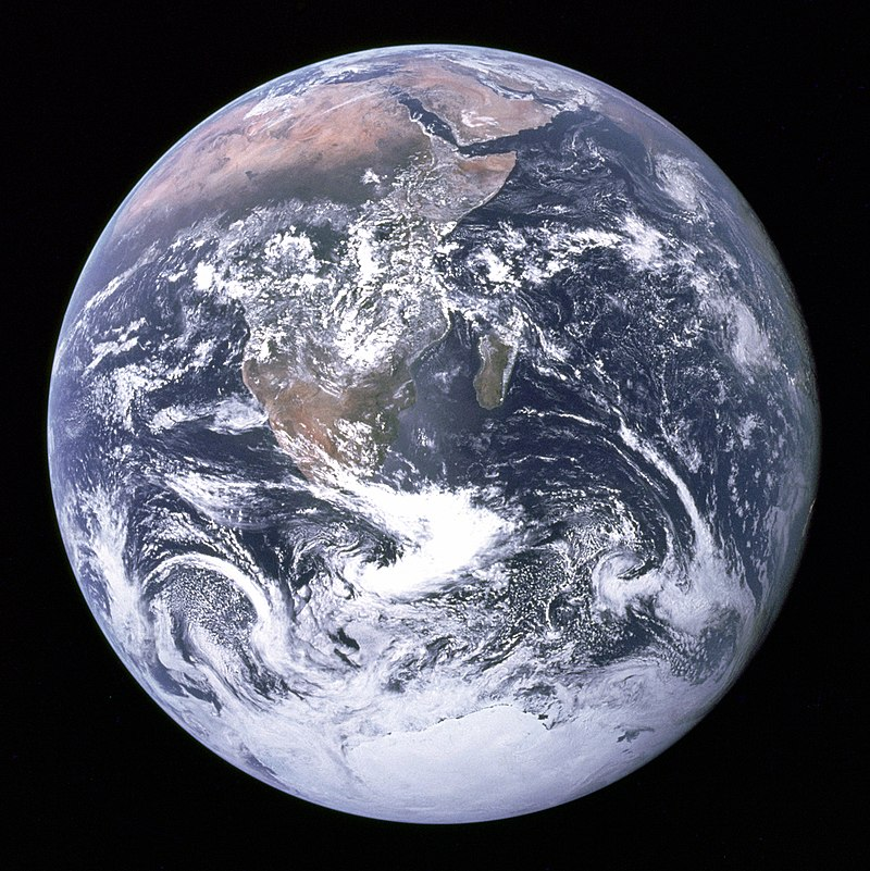 """The Blue Marble"" photograph of Earth, taken by the Apollo 17 lunar mission. The Arabian peninsula, Africa and Madagascar lie in the upper half of the disc, while Antarctica is at the bottom."
