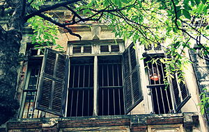 English: Open window of an old house, Nguyen S...