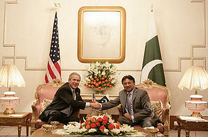 President George W. Bush is welcomed by Pakist...