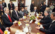 Yıldırım accompanying Recep Tayyip Erdoğan on a visit to the Polish Senate in 2009