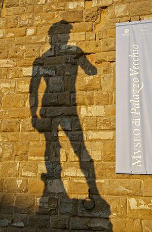 The evening light casts a shadow of a replica ...