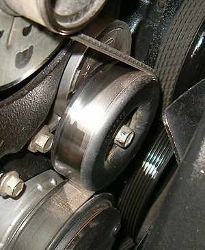 Tensioner in place on a model year 1999 7.4L a...