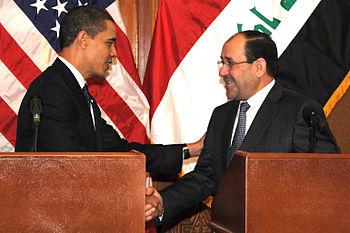 President Barack Obama shakes hands with Iraqi...