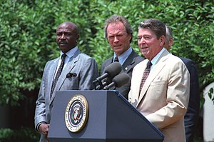 President Reagan speaking at a Take Pride in A...