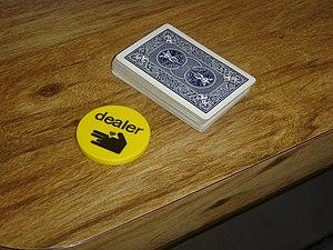 """A dealer button or """"buck"""" next to a ..."""