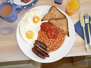 A full English breakfast, consisting of eggs, ...