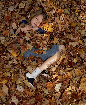 Girl under leaves.