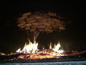 The temperature of a traditional brick bread o...