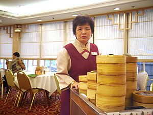 Lady serving Dim Sum in a restaurant in Hong K...