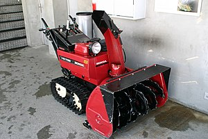 A heavy-duty walk-behind two-stage snow blower.