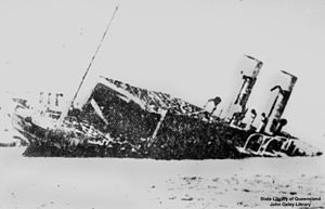 English: (ship) half-submerged and sinking.