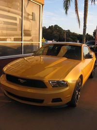 English: A yellow mustang (car) for sale