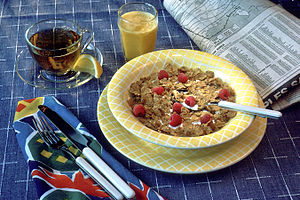 A breakfast is set up on a blue and white stri...