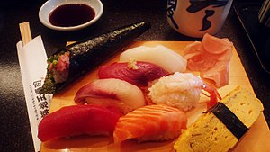 Many types of sushi ready to eat.