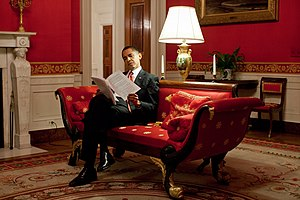 President Obama goes over notes in the Red Roo...