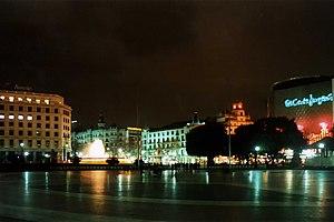 Plaça Catalunya at night.