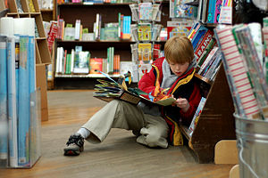 A child reading in Brookline Booksmith, an ind...