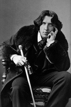 Oscar Wilde, three-quarter length portrait, fa...