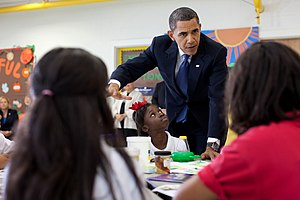 President Barack Obama has a discussion with s...
