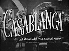 Black-and-white film screenshot with the title of the film in fancy font. Below it is the text
