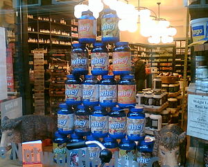 Containers of whey protein being sold at a hea...