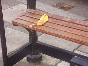 English: A banana peel lies on a seat at a bus...