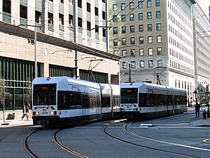 Two Hudson-Bergen Light Rail trains passing ea...