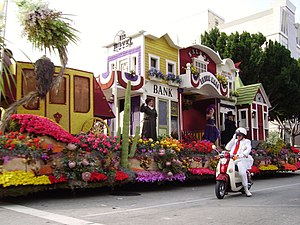Tournament of Roses Parade float with white co...