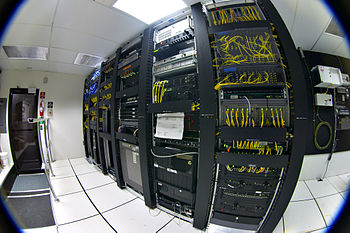 Racks of telecommunications equipment in part ...