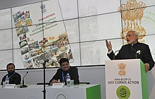 Modi (right) at CoP21 Climate Conference, in Paris, announcing the founding of an International Solar Alliance (ISA). November 2015.