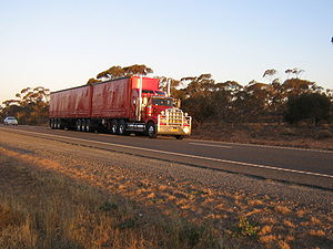 A red B-Double truck on the Sturt Highway at t...