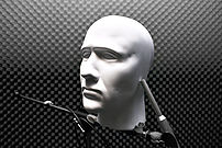 A dummy head being used as a binaural micropho...