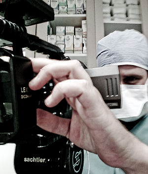James C. Mutter filming plastic surgery procedure.