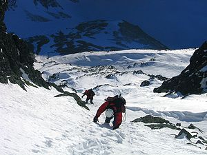 Two mountaineers descending a snow/ice gully f...