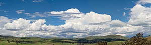 Cumulus humilis clouds in the foreground and c...