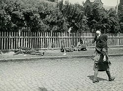 Passers-by no longer pay attention to the corpses of starved peasants on a street in Kharkiv, 1933