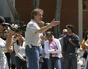 Evangelist Ray Comfort open-air preaching at a...