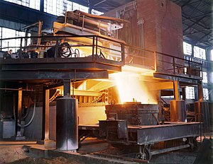 White-hot steel pours like water from a 35-ton...