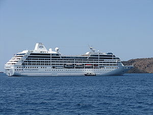 Azamara Quest anchored off Santorini.
