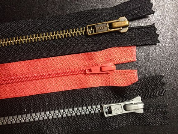 Coil plastic and metal zippers
