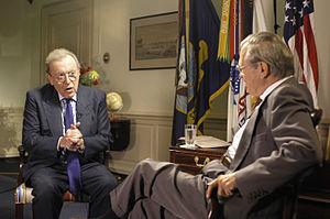 David Frost (left) interviewing Donald Rumsfeld