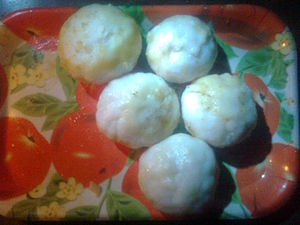 English: Pitha made from rice flour with cocnu...