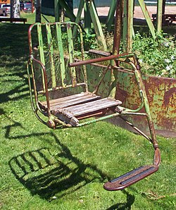ski lift chairs for sale gripper chair cushions no 1 wikipedia a metal painted green with footrest and wooden seat suspended above grassy