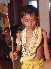 A Boy During His Upanayana Ritual The Thin Yellow Yajnopavita Thread Runs From Left Shoulder To Waist Note Munja Grass Girdle Around