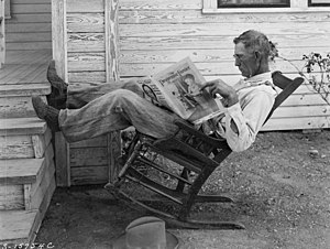 A Farmer Reading His Paper. Photographed by Ge...