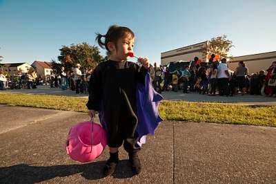 US Navy 111022-N-FG395-244 A child eats her candy after taking part in a Trunk or Treat event at Naval Submarine Base Kings Bay. More than 1,000 co