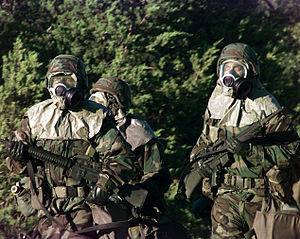 English: U.S. soldiers wearing full chemical p...