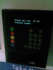 Electronic clocking terminal (Source: Wikimedia, February 2009)