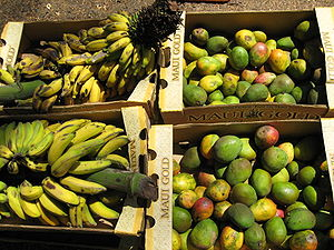 Mangoes and bananas in boxes.