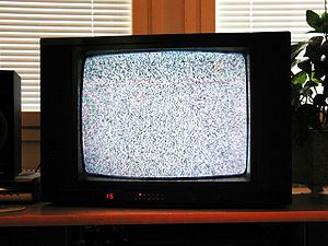 English: An analog TV showing noise, on a chan...